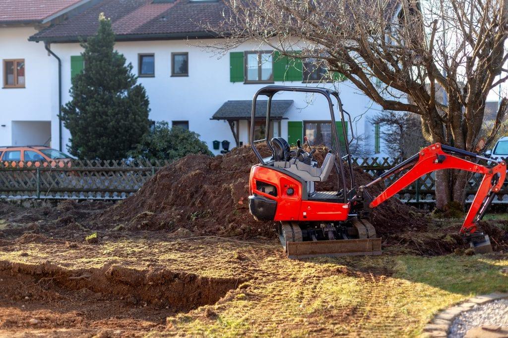 graafmachine minikraan minigraver tuin afgraven grond grondverzet