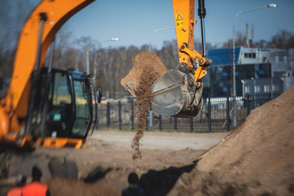 grondverzet graafmachine zand grond afgraven
