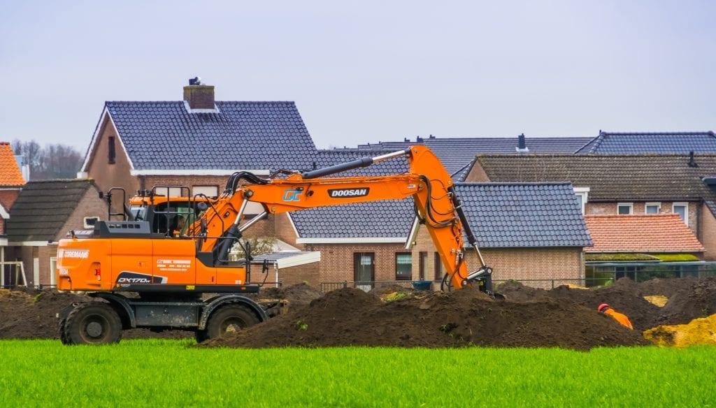 graafmachine nieuwbouw tuin grond afgraven